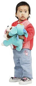 Young Asian child holding two stuffed animals