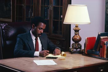 African American attorney writing notes