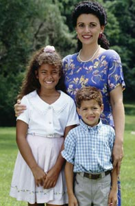 Image of a Hispanic mother and her children