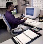 African-American working at computer in office