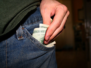 Photo of hand removing cash from pants pocket